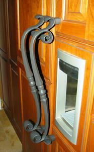 First Impressions Heavy Duty scroll door handle on refrigerator.