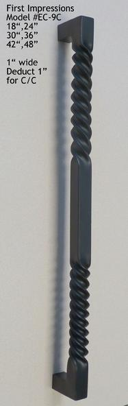 Twisted, mitered aluminum pull that we powder coated in black.