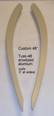 Elephant tusk shaped door pull handle in anodized aluminum.