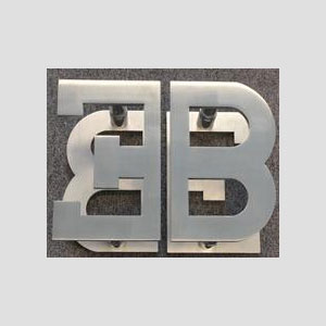 A Set Of Eb Logo Handles Back To Mounted In Brushed Stainless Steel